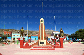 Statues of local people in traditional dress in village square, Curahuara de Carangas, Oruro Department, Bolivia