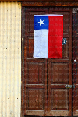 Chilean flag on wooden door, Arica, Region XV, Chile