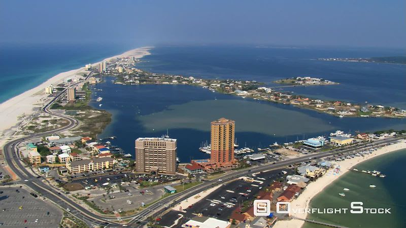 Wide aerial orbit of Pensacola Beach, Florida including beach.
