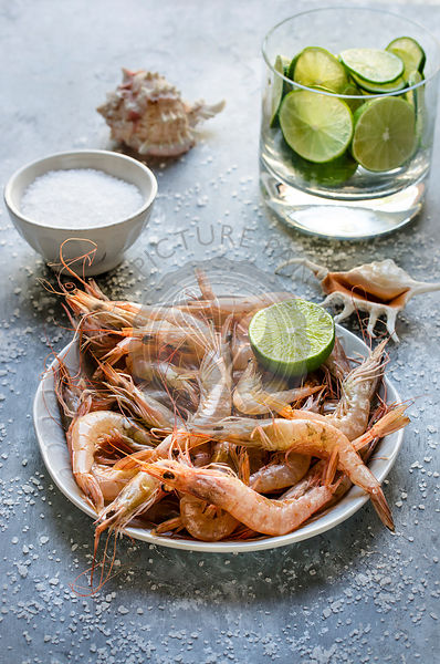 Fresh Shrimps in a bowl with lime