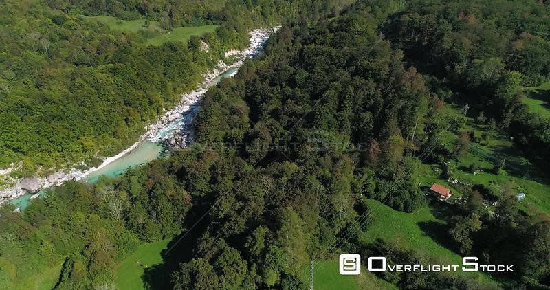 Mountain rapids, C4K aerial sideway drone view of a turquoise soca river, near Trigolov national park, on a sunny summer day, in the Julian alps, Slovenia