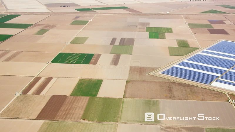 Aerial View of Patchwork Fields and Large Photovoltaic Plant, Spain