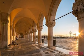 Colonnade of Doge's palace at sunrise, Venice, Italy