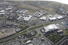 Widnes high level aerial photograph looking across Ashley Way towards Fiddlers Ferry road and Dennis road and the Industrial estates and Business and retail Parks in the area and the waterfront of the river Mersey