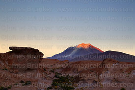 Eroded volcanic rock formation and first light on Cerro Ollagüe volcano, Nor Lípez Province, Bolivia