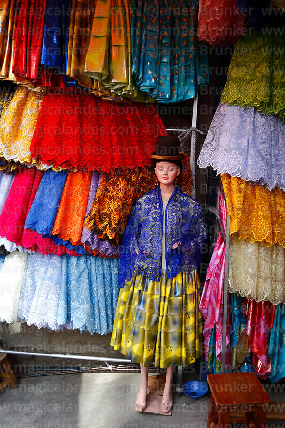 Mannequin dressed as a cholita and skirts / polleras for sale in traditional clothes shop, La Paz, Bolivia