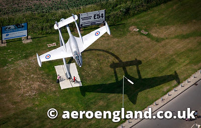 aerial photograph of a preserved  former Swiss airforce de Havilland DH 112 Venom restored as a gate guardian in i  , Oxfordshire England UK
