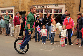 Unicyclist Performing Stunts at Olympic Torch Relay