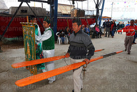 Man carrying oars to altar before holy communion during mass for St Peter and St Paul festival, Arica, Chile