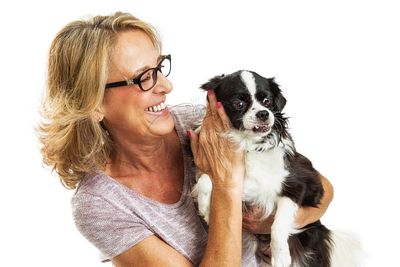 Happy Woman Petting Little Dog