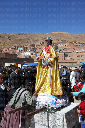 Indigenous lady kisses the robe of San Bartolome during procession at start of Chutillos festival, Potosí, Bolivia