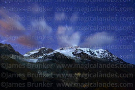 Rising moon lights up clouds and glaciers of Mt Huayna Potosí, Cordillera Real, Bolivia