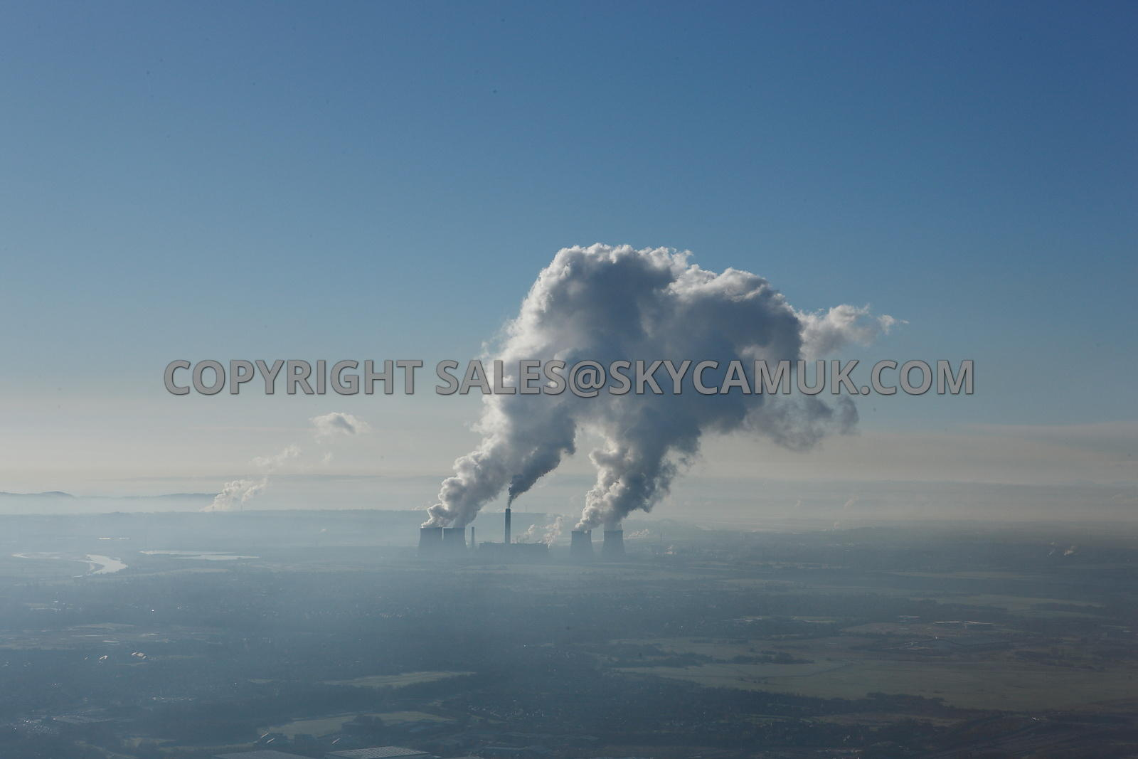 Fidders Ferry aerial photograph of plumes of steam rising above the power Station against a clear blue sky