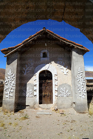 Quinoa plant designs on facade of rustic church in Churacari village, Bolivia