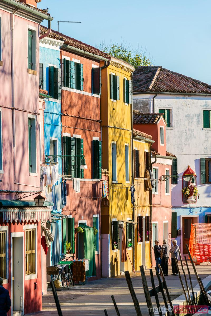 Old women in the streets of colourful Burano, Venice, Italy