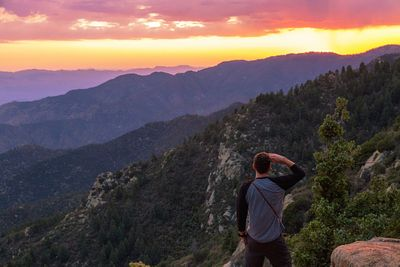 Man Looking Out into Mountain Sunset