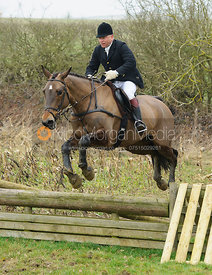 James Mossman jumping the hunt jumps at Peake's Covert