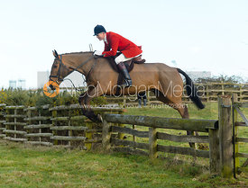 Ashley Bealby jumping a hunt jump at Hill Top Farm