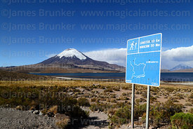 Sign next to Lake Chungará showign hiking tails, Parinacota volcano in background , Lauca National Park, Region XV, Chile