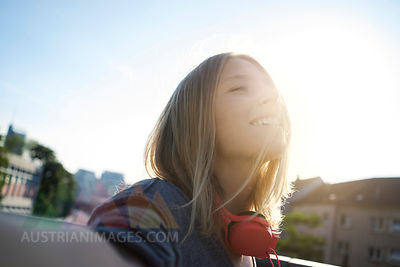 Portrait of happy young woman enjoying sunlight