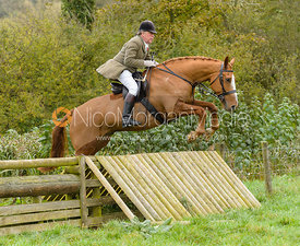 Johnnie Arkwright jumping the hunt jump at Peakes Covert