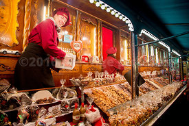 Young Woman Laughing as she Works on a Confectionary Stand at the Rathausmarkt Christmas Market