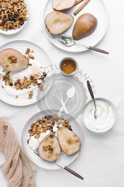 Poached Pears served with yogurt and maple granola.