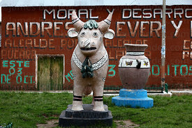 Ceramic bull and political propaganda in village of Pucará , Puno department , Peru