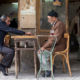 Men play backgammon outside a cafe on Hamid Farid Street in Downtown Cairo