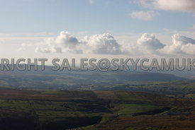 Lancashire aerial photograph of Clouds over farm land and the Moors of Inchfield and Todmorden ancient moorlands