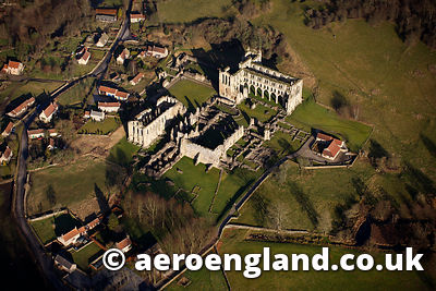 aerial photograph of Rievaulx Abbey ,  a ruined  Cistercian abbey in Rievaulx, near Helmsley in the North York Moors National Park, North Yorkshire,  Yorkshire England UK