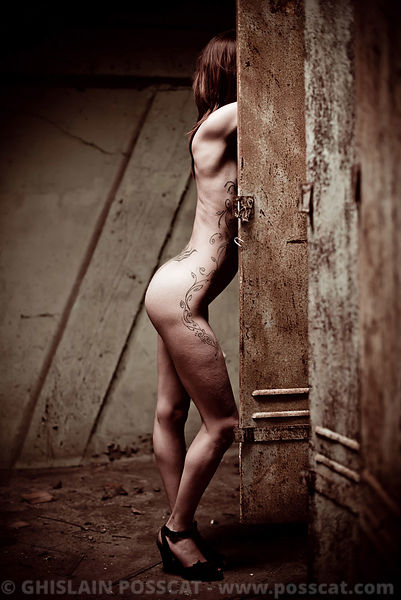 Nude picture of naked fit woman in a cloackroom