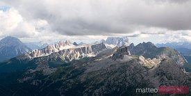 Mountain range with low clouds in the Dolomites Italy