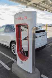 BAKER, USA - FEBRUARY 16, 2018: A Teslr Model X car being charged at the Tesla Supercharger charging station at Baker in southern California.  This site has 40 Superchargers.