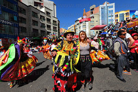 Waca waca bull dancer with European tourist at Gran Poder festival, La Paz, Bolivia