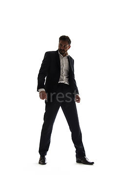 A mystery man in a suit, standing, in semi-silhouette – shot from low level.