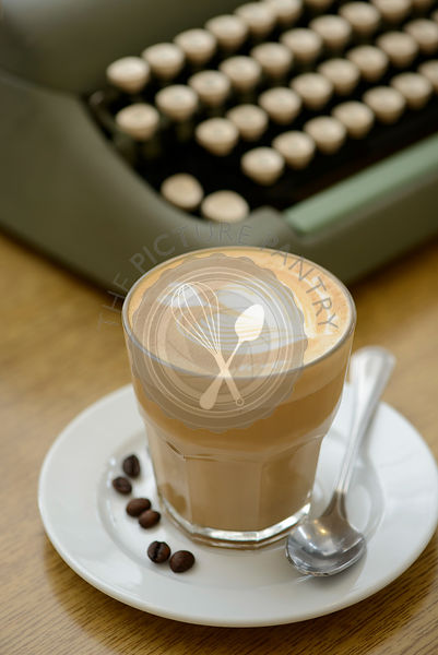 A glass cup of cafe latte with latte art