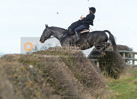 Sophie Walker jumping a hedge at Leicester Lane