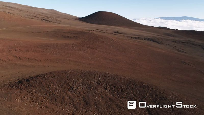 Flying over red cinder cones on Mauna Loa, Hawaii.