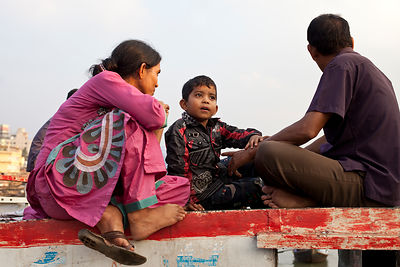Bangladesh - Dhaka - A boy and his parents waiting on the deck of a ferry at Sadarghat
