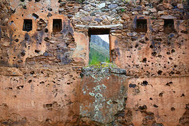 Trapezoid doorway and niches in upper level of  building in Inca site of Pumamarca, Patacancha Valley, Cusco Region, Peru