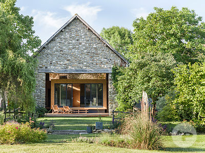 Wooden cabin in a barn by Delphine Waiss Architecture.