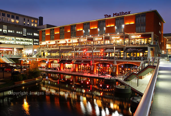 The Mailbox development at night, showing bars and restaurants along the canal. Birmingham, West Midlands, England, UK