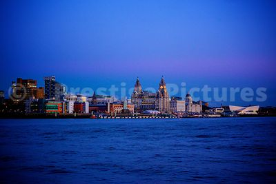 The Pier Head Waterfront at dusk Viewed across The Mersey