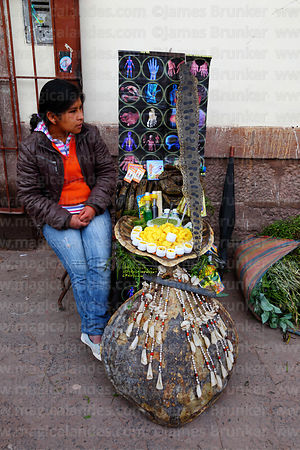 Girl selling ointments and traditional medicine made from snakes in market, Cusco, Peru
