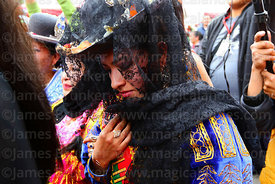 A cholita wearing a black veil (to symbolise mourning) during parades for the Entierro del Pepino, La Paz, Bolivia