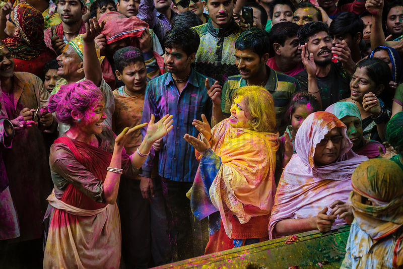 Revellers Dance During Holi Celebrations at Dwarkadheesh Temple