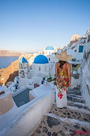 Woman walking in the town of Oia, Santorini, Greece