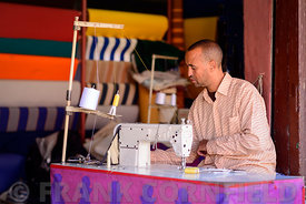 Man at his sewing machine