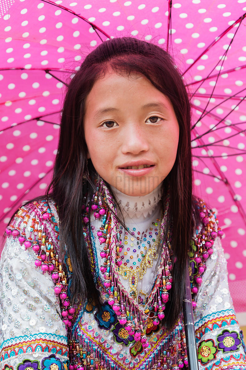 Portrait of a Flower Hmong Woman with a Pink Umbrella